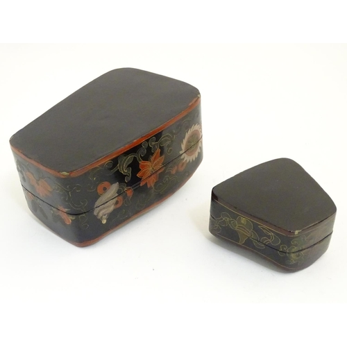 1072 - Two Oriental papier mache boxes of shaped form with flower and foliate decoration. Largest approx. 3...