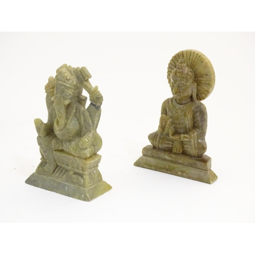 1076 - Three assorted soapstone carvings to include a model of the Indian deity Ganesh, a model of Buddha, ...