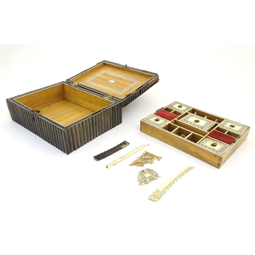 1079 - A 19thC Anglo Indian horn sewing box, the body with reeded detail, the lid surmounted by a model of ...