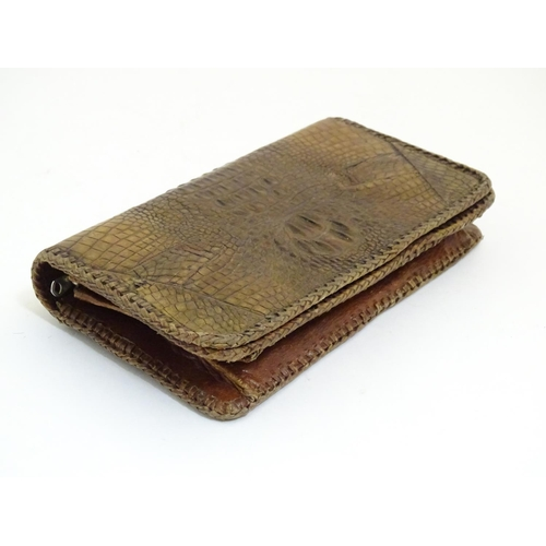 1082 - An early 20thC crocodile skin clutch handbag, with Reptile Store, Singapore label within. Approx. 5