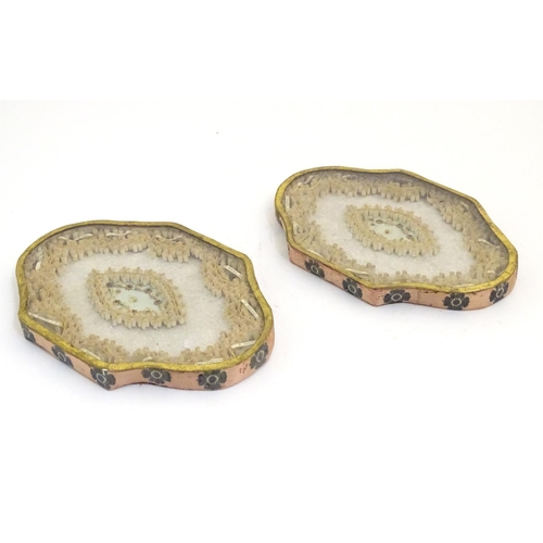 1100 - A pair of early 19thC French reliquaries decorated with gilt edged rolled paper / quilling with dedi...