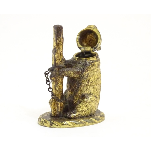 1103 - A 19thC brass go to bed vesta case formed as a bear and tree trunk. Approx. 3