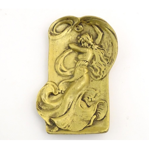 1108 - An Art Nouveau brass plaque with embossed decoration depicting a lady with flowing drapery. Approx. ...