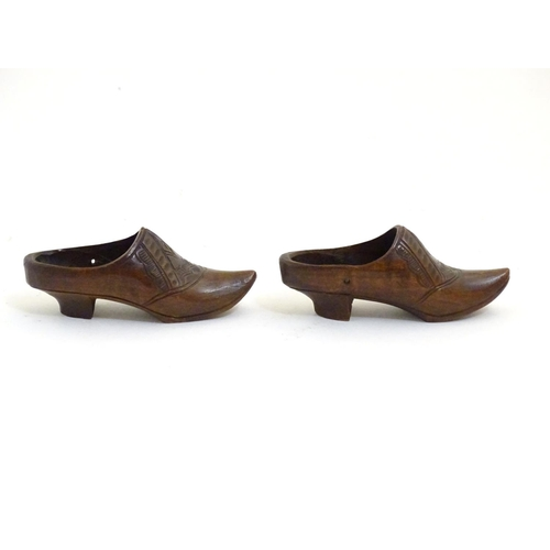 1115 - A pair of 20thC carved miniature clogs. Approx. 3 3/4