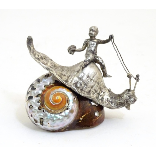 1117 - A 20thC novelty desk ornament modelled as a cherub riding the body of a snail with a shell base. App...
