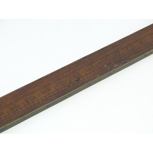 1133 - A large Victorian rule / ruler with brass mounts. 44