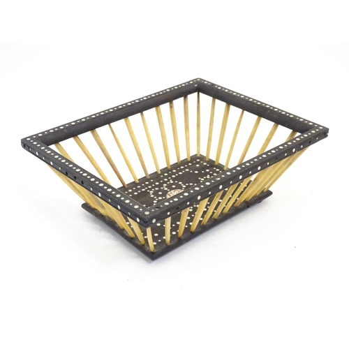 1171 - A late 19thC Anglo-Indian ebonised wood and porcupine quill basket of rectangular form with inlaid r...
