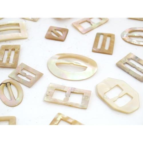 1175 - A quantity of mother of pearl buckles of rectangular, circular and oval form. Approx. 2 1/4