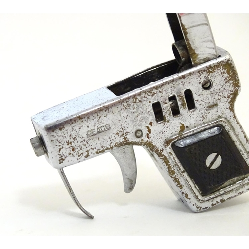 1184 - A novelty lighter modelled as a pistol / hand gun. Approx. 2 1/4