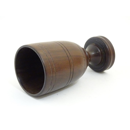 1189 - An early 20thC treen turned goblet with banded detail, possibly laburnum. Approx. 6 3/4