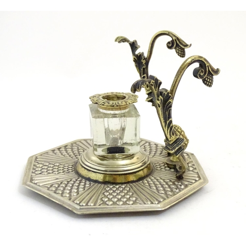 1190 - An Indian silver plate and brass standish with an octagonal base, central glass bottle, pen rest wit...