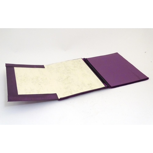 1201 - A Victorian desk blotter / stationery folder with a purple velvet covering and applied silver mounts...