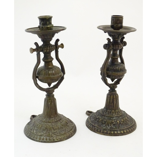 1206 - A pair of late 19thC cast gimbal mounted candlesticks with foliate decoration, with bracket to base ...