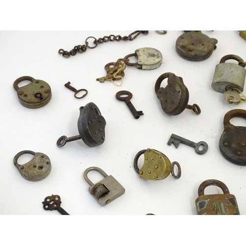 1211 - A quantity of assorted Victorian and later padlocks, to include some military examples with the broa...