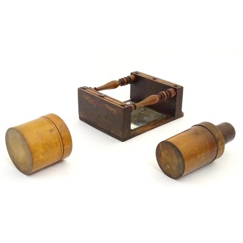 1215 - Two 19thC treen items comprising a turned wooden medicine bottle case and a cylindrical pot and cove...