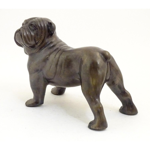 1223 - A 20thC cast model of a standing dog / bulldog. Approx. 6 1/2