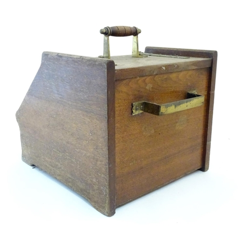 1229 - A Victorian oak coal scuttle in the manner of Christopher Dresser with carved detail brass mounts an...