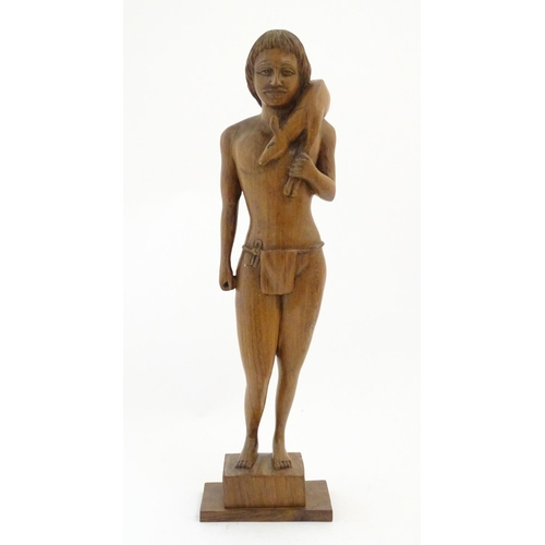1144 - A 20thC wooden carving depicting a male hunter carrying a deer. Approx. 18 3/4