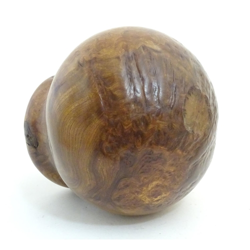 1146 - A 20thC Welsh burr elm turned vase with a bulbous body by Paul Clare. Signed under. Approx. 9 1/4