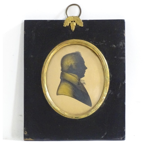 971 - A 19thC oval silhouette portrait miniature depicting a gentleman in a jacket and tie / cravat, with ...