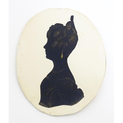 972 - A 19thC oval silhouette portrait miniature depicting a woman in profile, with gilt highlights. Appro...