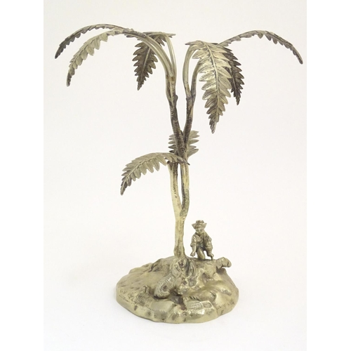 982 - A Victorian centrepiece / epergne stand cast as a boy and a dog with a stylised palm tree. Approx. 1...