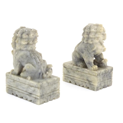 983 - A pair of Oriental carved soapstone foo dogs. Together with another smaller pair. The larger pair ma...