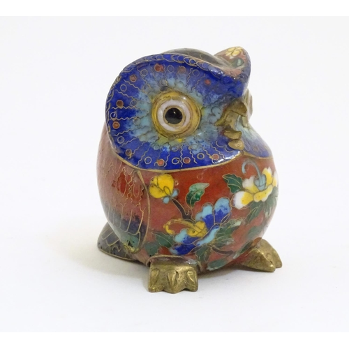 1044 - A 20thC cloisonne model of an owl with floral and foliate detail. Approx. 3