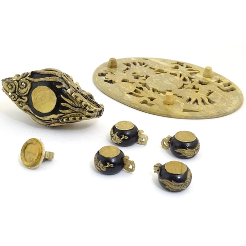 1059 - An Oriental soapstone teapot, tray and cups. The oval tray with carved openwork detail depicting dra...