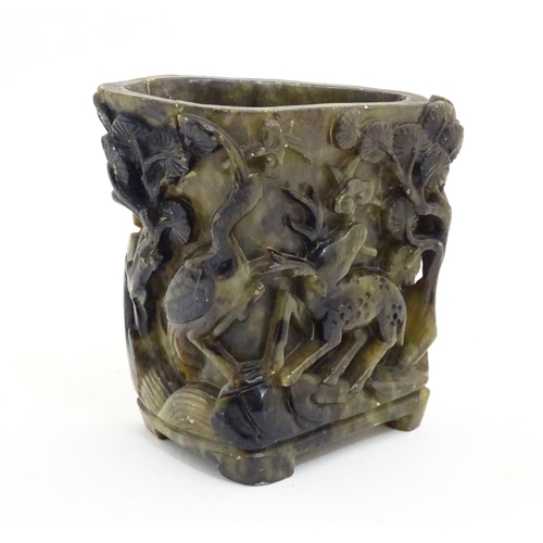 1060 - An Oriental carved soapstone libation cup / vase / brush washer pot, depicting a mountain landscape ...