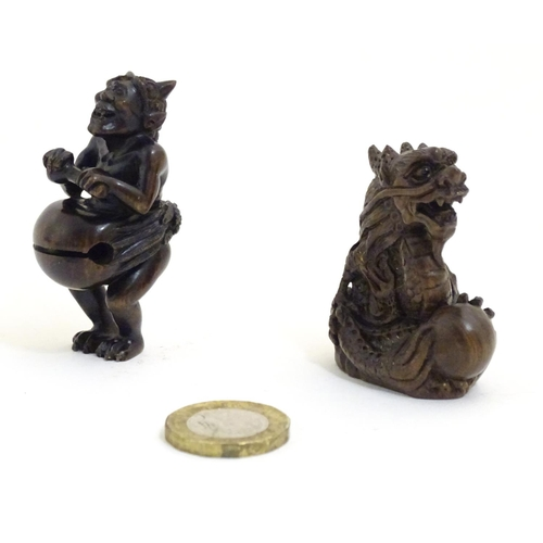 1067 - Two Japanese netsukes, one depicting a dragon with a pearl, signed under. The other netsuke modelled...