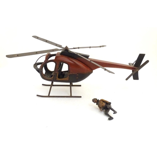 1258 - A 20thC wood and steel model of a helicopter and pilot with polychrome decoration. Approx. 11 1/4