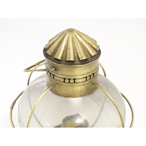 898 - A lifeboat / ships lamp by Sherwoods Ltd Birmingham with glass globe. Approx 11