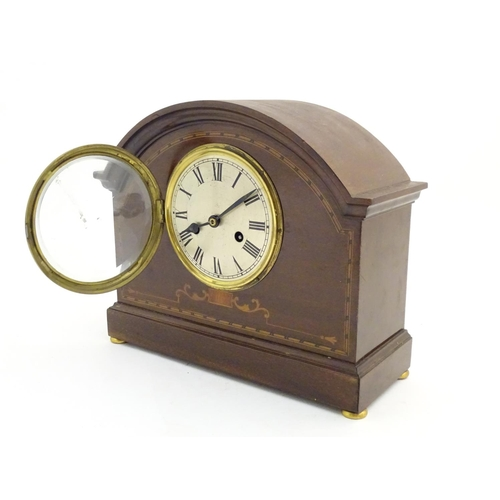 921 - An early 20thC mantle clock / timepiece, the mahogany case with inlaid decoration. Approx 11 1/2