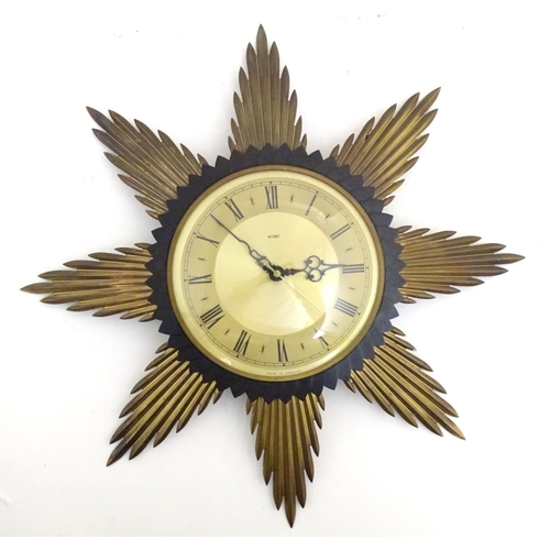 934A - A vintage/ retro Metamec Starbursh wall clock with quartz movement 17 1/2