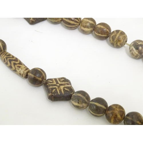 951 - Ethnographic / Native / Tribal: Two African necklaces comprised of clay beads with geometric decorat...