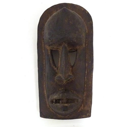 958 - Ethnographic / Native / Tribal: A carved African Dogon mask. Approx. 17 1/4