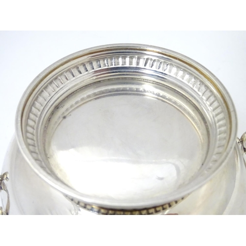 457 - A silver porringer and cover hallmarked London 1964, maker Edward Barnard & Sons Ltd.  6 1/4