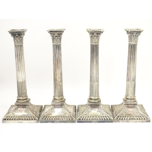 484 - A set of 4 silver plate Corinthian column candlesticks with acanthus detail . Approx 11
