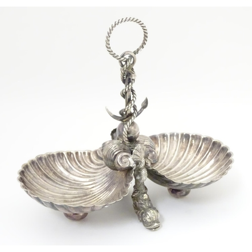 485 - A late 19thC / early silver plate dish with twin scallop shell formed bowls united by an anchor and ...