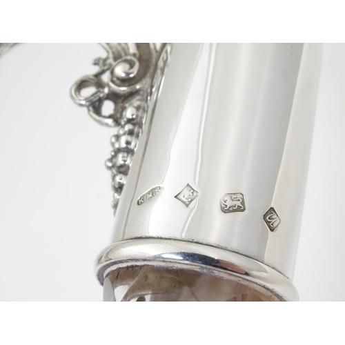 486 - A Silver mounted cut glass claret jug  / ewer with fruiting vine decoration. Hallmarked Birmingham 1...