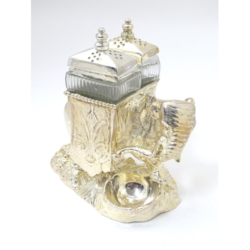 487 - A late 20thC / 21stC novelty cruet formed as  as an elephant carrying pepperettes. Approx 4 1/4