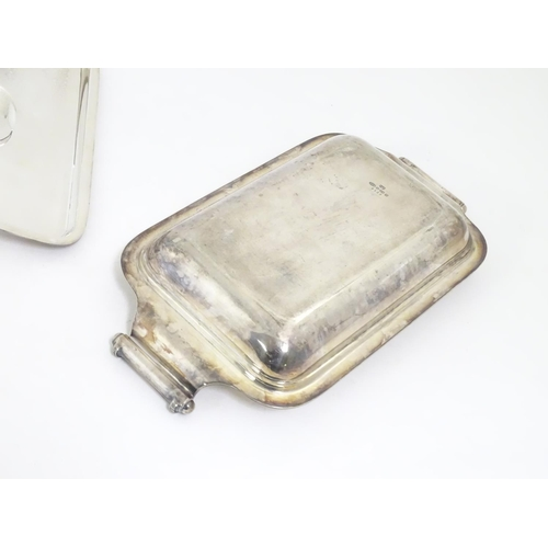 490 - A silver plate entree dish with outwept handles. 13