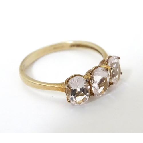514 - A 9ct gold ring set with trio of pink tourmaline. the ring size approx R