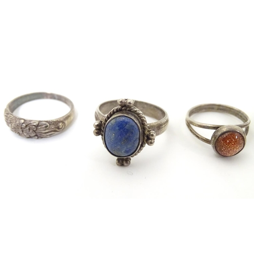 537 - Six assorted silver and white metal rings with various decoration including one set with goldstone c...