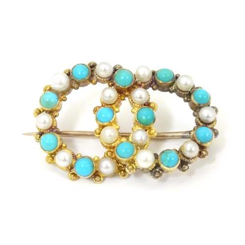 543 - A Victorian gold and gilt metal brooch set with turquoise and seed pearls 1 1/2