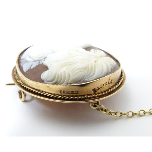 544 - A 20thC shell carved cameo brooch in a 9ct gold mount. 1 1/2