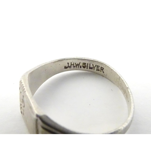 553 - Eleven assorted silver and white metal rings (11)