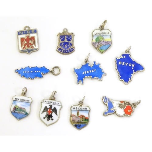 554 - Assorted silver and silver plate charms including 3 silver pendant charms with blue enamel decoratio...
