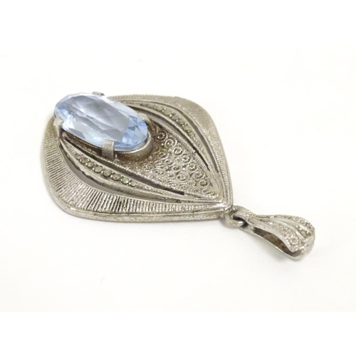 561 - Fahrner Theodor : A 20thC silver pendant set with aquamarine stone and marcasite detail. marked TH s...